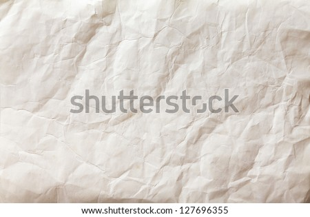 white sheet of paper folded and battered, with texture.