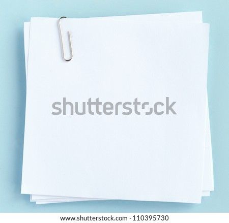 white sheet of paper on a blue background