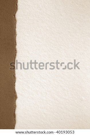 white sheet of paper with brown border on the left
