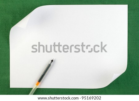 White sheet of paper with curled edge on green background