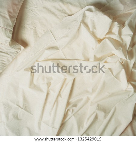 White sheets in bed