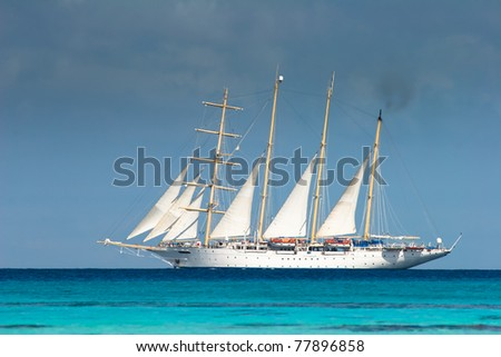 White ship swimming through the waters of Pacific, Fakarava, French Polynesia
