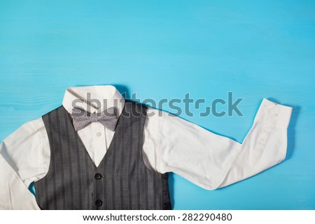 white shirt, gray vest and a bow tie on a bright blue background, the concept of the festival, celebrations, ceremonies happy Father\'s Day, Happy Birthday Dad