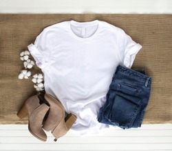 White shirt mockup - tshirt with cotton plant, burlap, boots and jeans