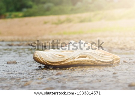 White shoes on stone in riverside with blur background #1533814571
