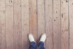 white shoes on wooden planked floor from above
