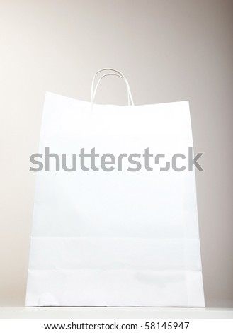 White Shopping Bag over gray background, studio shot