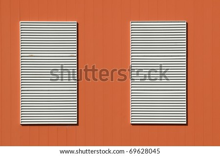 White shutters on terracotta wall