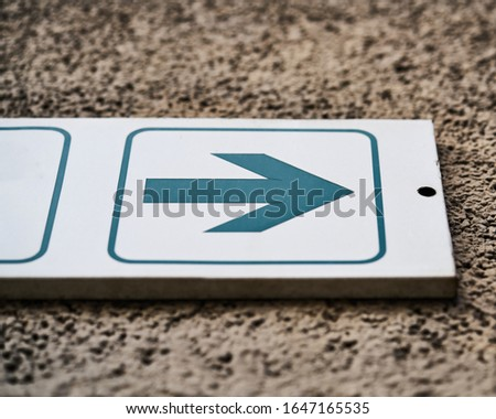 white sign with green arrow Stock photo ©