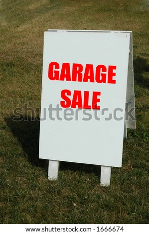 white sign with word garage sale