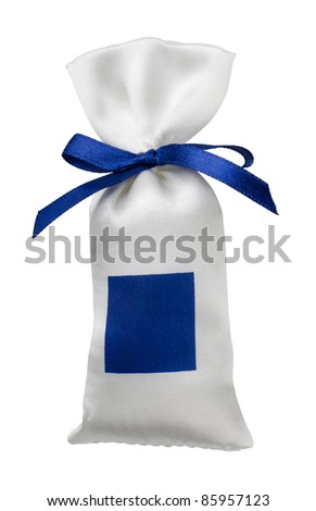 White silk gift bag with empty blue label isolated on white