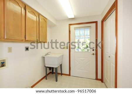 White Simple Laundry Room With Sink And Cabinets. Stock Photo ...