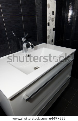 white sink with chrome faucet