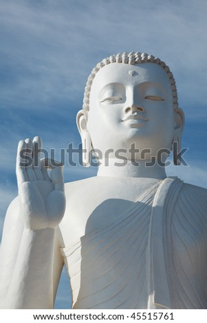 White sitting Budha image close up. Mihintale, Sri Lanka