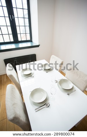 White small table with four table setting