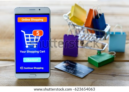 White smart device shows an online shopping screen app with five items in a basket and waiting for customer / shopper to confirm and checkout. Online shopping, online digital money payment concept. #623654063