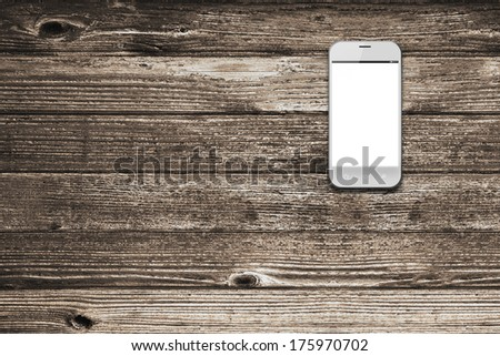 White smart phone with isolated screen on an old wooden desk