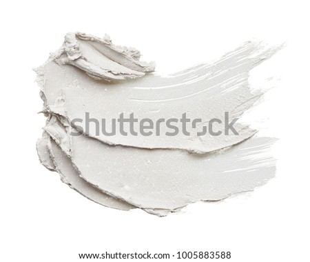 White smear and texture made with face clay or cream isolated on white background.