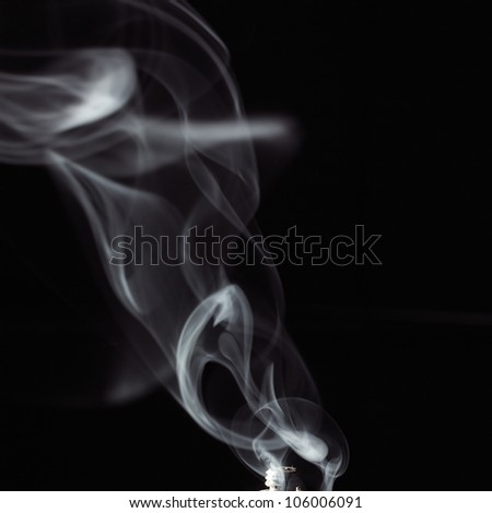 white smoke against a black background