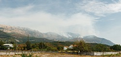 White smoke in the mountains of Montenegro. Large source of fire ignition in smoke.