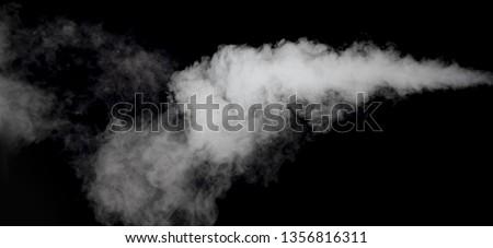 white smoke long tails isolated on dark background  #1356816311