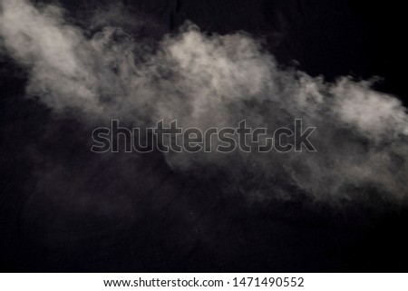 white smoke natural blowing isolated on dark black background #1471490552
