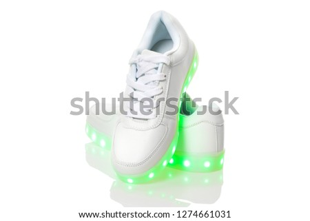 White sneackers with led light sole. Isolated over white background.