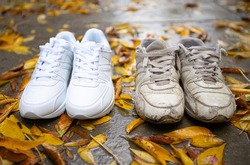 White sneakers are old and brand new nearby