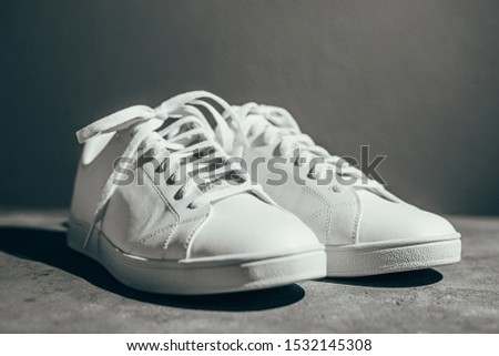 White sneakers on gray background. Stylish white sneakers