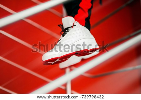 White sneakers on red background. Wallpaper. Hype sneaker