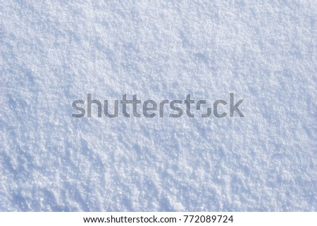 White snow texture, background of fresh snow texture in blue tone #772089724