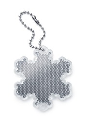 White snowflake safety reflector keyring isolated on white