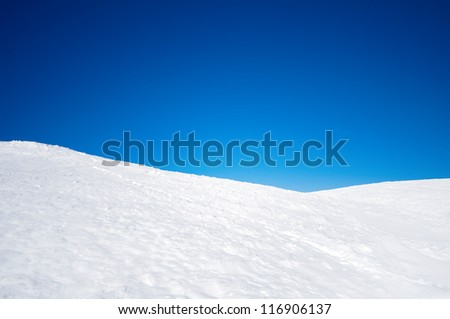 White Snowy Fields Under A Blue Sky