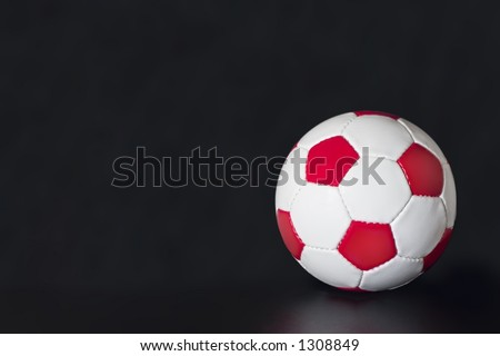 White Soccer Ball with red pentagons and white hexagons