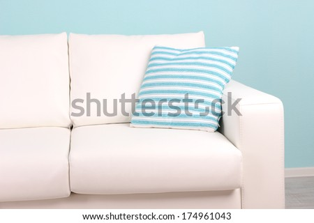 White sofa close-up in room on blue background #174961043