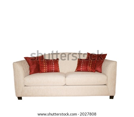White sofa with decorative red pillows isolated on white
