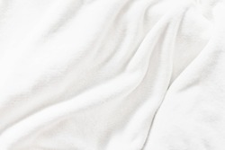 White soft wrinkle fleece synthetic cloth blanket texture background, wallpaper, backdrop. Space for text.