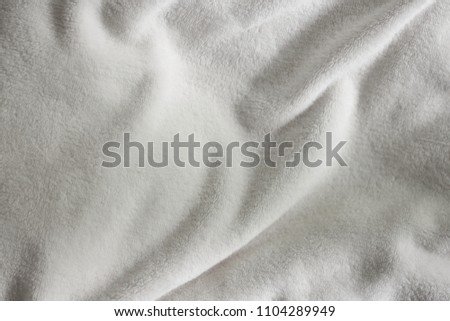 soft blanket texture. White Soft Wrinkle Fleece Synthetic Cloth Blanket Texture For Background,  Wallpaper, Or Backdrop With