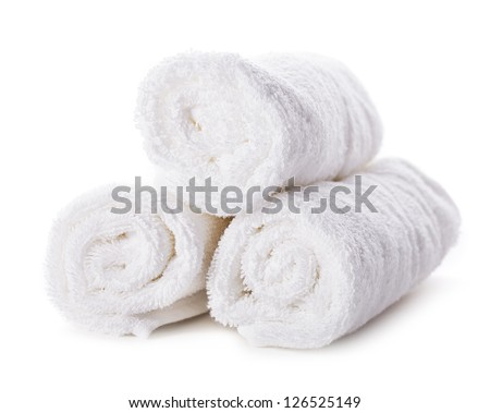 White spa towels pile isolated on white background
