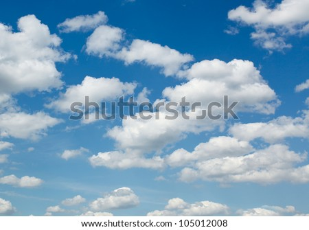 White sparse clouds over blue sky