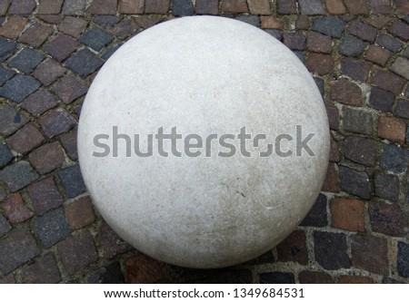 White sphere on a cobblestone floor Stockfoto ©