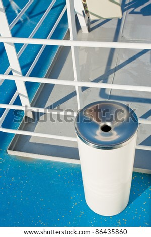 white spittoon on deck of cruise liner