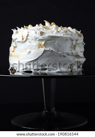 White sponge cake with icing on black
