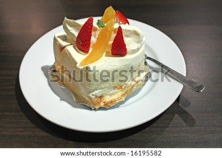 White Sponge Cream Cake in a Restaurant