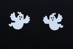 White spooks silhouettes on black Halloween background