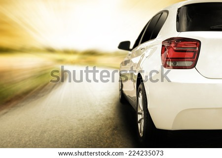 white sport car without a trade brand and sunset