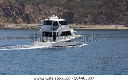 White sportfisher yacht underway