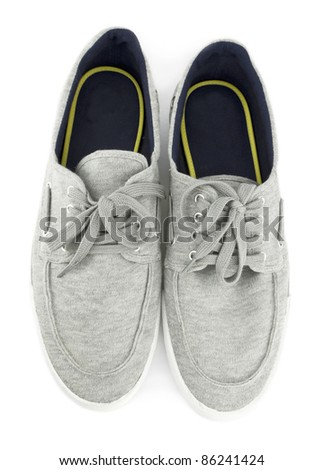 White sports shoes on white background