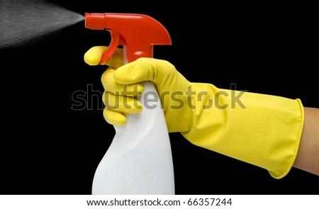 White spray in hand on black background