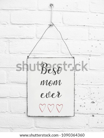 White square metal plate on white brick background - mock up template - Happy mothers day for mom with cute red hearts #1090364360